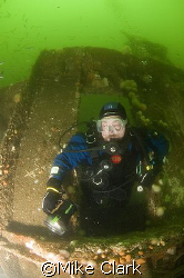 Diver exits Unity wreck. Moray Firth  Scotland nikon d... by Mike Clark