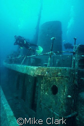 Diver fins above Rozi Wreck Companionway. Malta. Nik V... by Mike Clark