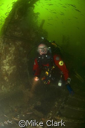 Diver on the wreck of the Unity, Moray Firth, Scotland.... by Mike Clark