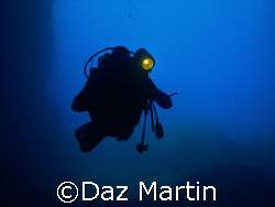 My Mate entering Cathedral Cave on Comino, Malta, May 2007. by Daz Martin