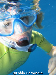 Snorkeling. Taken at Tremiti islands 21/07/07 by Fabio Peracchia