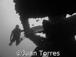 Nice B & W of my wife at the Hilma Hooker, Bonaire.   by Juan Torres