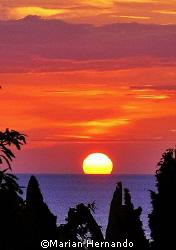 Manado Bay Sunset. by Marian Hernando