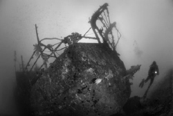 Exploring a wreck in Fiji by Andy Lerner