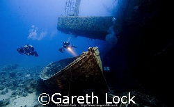 Lifeboats lying along side the Salem Express wreck in the... by Gareth Lock