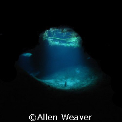 Light at the end of the tunnel.   Inside a cave in the Me... by Allen Weaver