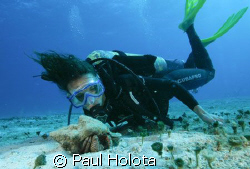 Christina gets up close to a hermit crab. Cozumel. Canon ... by Paul Holota