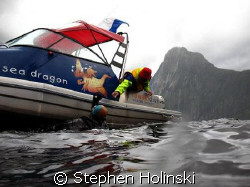 More Weight Please!  Diving in Milford Sound, New Zealand... by Stephen Holinski