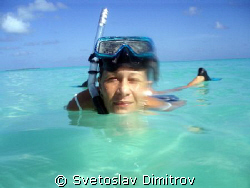 My wife has just finised her snorkeling by Svetoslav Dimitrov