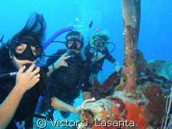 My Jr. Open Water Divers making their first dive on a B-2... by Victor J. Lasanta