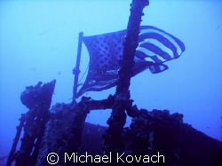 Flag on the wreck of the Duane out of Key Largo. by Michael Kovach