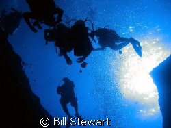 Divers ascending from the Blue Hole.  Photo taken on 8 De... by Bill Stewart