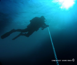 Diver decompressing on an ascent line, on one of the many... by Steve Jarocki, Jr.