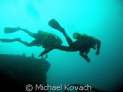Divers on the Duane out of Key Largo by Michael Kovach