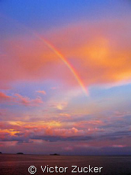 Rainbow at sunset by Victor Zucker