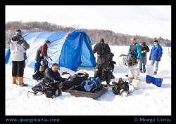 Divers preparing for ice diving in MN. The ice was 2 feet... by Margo Cavis