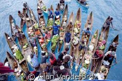 Market Day aboard Bilikiki at the Florida Island Group, S... by Allan Vandeford