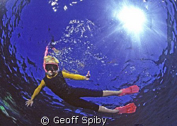 young snorkeller by Geoff Spiby