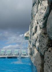 Resort pool with waterfall, Grand Cayman.  by David Heidemann