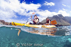 Kayaking  by Victor Amor