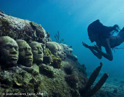 Marie free dives down to underwater faces. Jason deCaires... by Jason Decaires Taylor