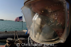 Navy Diver takes a moment to pray before entering the wat... by Christopher Perez