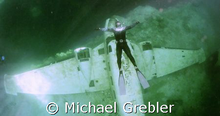 Free Diver over plane, photo taken March 16 under the ice... by Michael Grebler