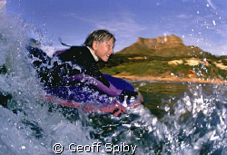 the excitement of riding a wave shows on the face of this... by Geoff Spiby