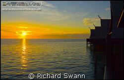 Sunrise over Kapalai Dive Resort. Nikon D2x by Richard Swann