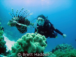 Stare Down between Angie and a Huge Lion Fish..... EEL Ga... by Brett Hadden