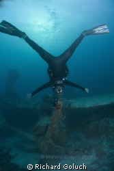 Human propeller over engine propeller-Truk Lagoon by Richard Goluch