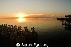 Sunset in Mabul homestay. by Soren Egeberg