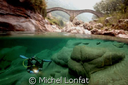 Beautiful dives in the great waters of the Verzasca River. by Michel Lonfat