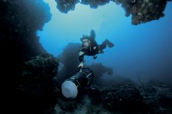 Tech diver and scooter exploring coral reefs , sodwanan s... by Andrew Woodburn