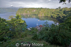 A view from my balcony at Tufi Dive Resort, overlooking t... by Terry Moore
