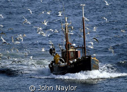 fishing boat returning to port by John Naylor