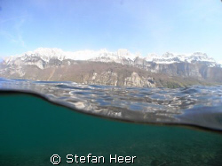 A lake in the mountains of Switzerland by Stefan Heer
