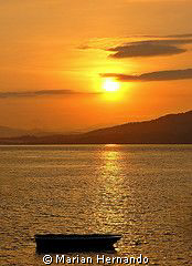 Early morning in Bunaken island at 6am while preparing fo... by Marian Hernando
