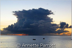 Cumulonimbus. Sunset. Fishing boats in the distance. by Annette Parrott