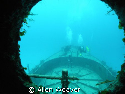 looking through the wheelhouse window at the forward gun ... by Allen Weaver