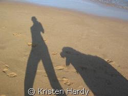 best friends by the sea at sundown. by Kristen Hardy