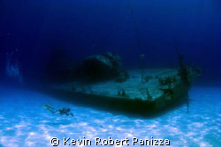 Videographer shooting the Shipwreck Tibbits in Cayman Bra... by Kevin Robert Panizza