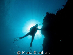 Cath hanging above me at Pescador Island in Moalboal, Cebu by Mona Dienhart