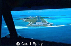 coming in to land at Hlulule airport, Maldives by Geoff Spiby