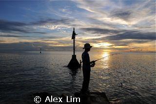 Sunset fishermen at Layang Layang by Alex Lim