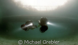 Divers on DPV pass under the floating bridge in Morrisons... by Michael Grebler