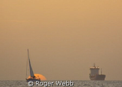 Bequia at sundown... by Roger Webb