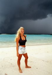 Claudia and the Cyclone cloud, Maldives.  by Leon Joubert
