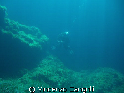 Divers raising from the blue.