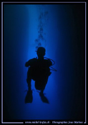 Diver in the cave of the Inland Sea in Gozo - Malta by Michel Lonfat